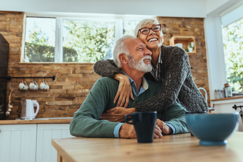 Elderly couple in their new home